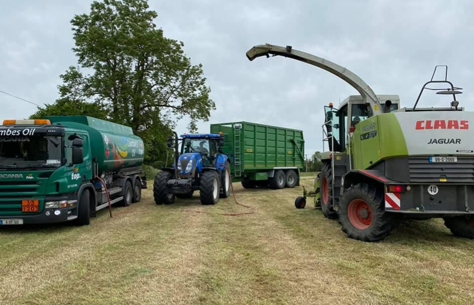 Lambes Oil truck delivering Commercial Diesel to a tractor in a field