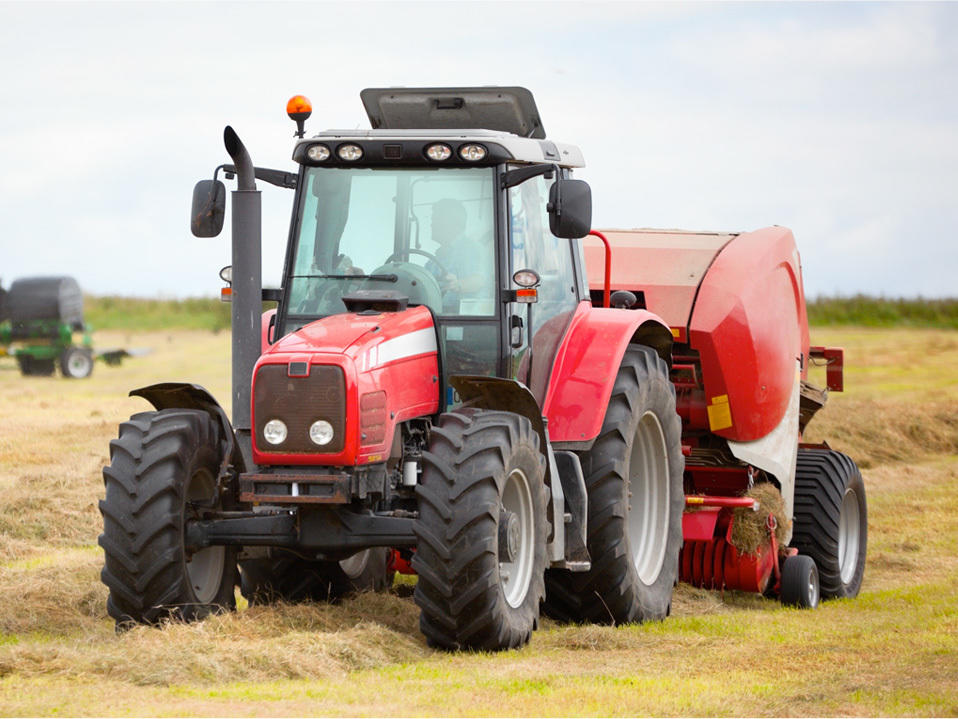 Tractor filled with Lambes Gas Oil bailing hay