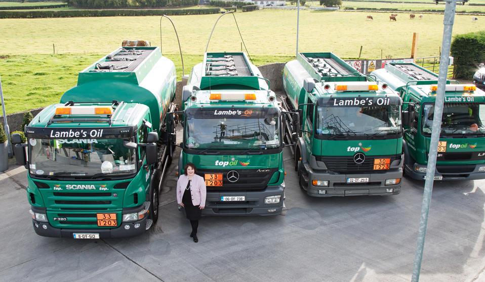 Rita Lambe standing in front of Lambes Oil Fleet