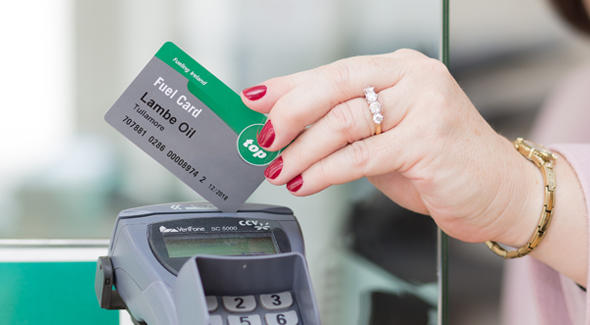 Customer swiping their fuel card in a payment terminal