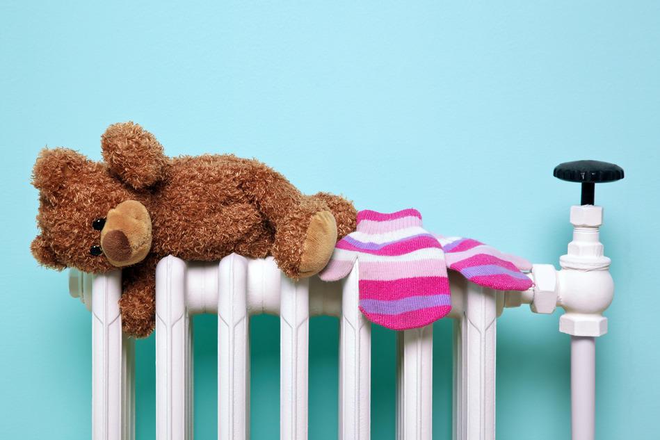 Teddy bear lying on a warm radiator heated by Lambes Oil